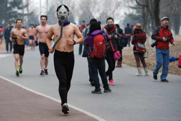 Chinese runner in gas mask