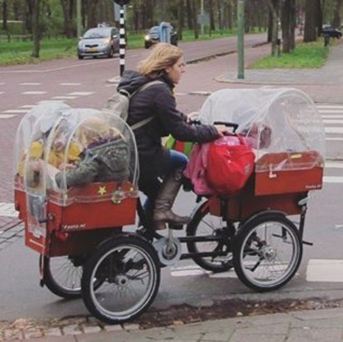 Mom and kids on 4-wheeled bike
